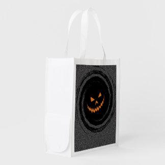 Halloween Glowing Jack O'Lantern in a black swirl Reusable Grocery Bag