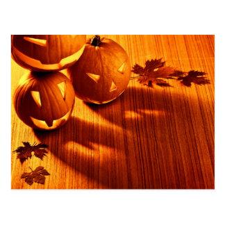 Halloween glowing pumpkins border postcard