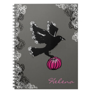 halloween illustration of a raven and a pumpkin notebook
