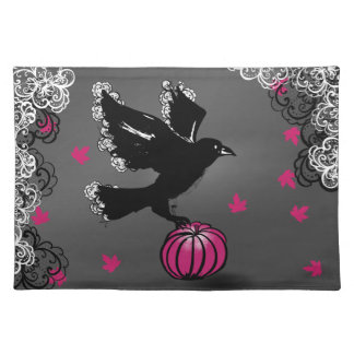 halloween illustration of a raven and a pumpkin placemat