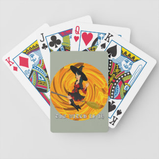 Halloween the witch is in bicycle playing cards