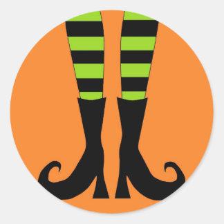Halloween Witch Feet in Green Orange Background Classic Round Sticker