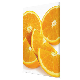 Halves and quarters of ripe, juicy, sweet canvas print