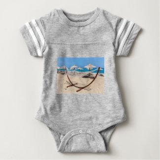 Hammock with beach umbrellas at coast baby bodysuit
