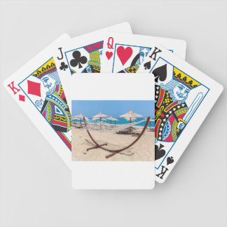 Hammock with beach umbrellas at coast bicycle playing cards