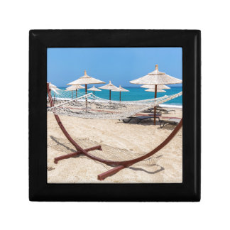 Hammock with beach umbrellas at coast gift box