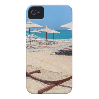 Hammock with beach umbrellas at coast iPhone 4 cases