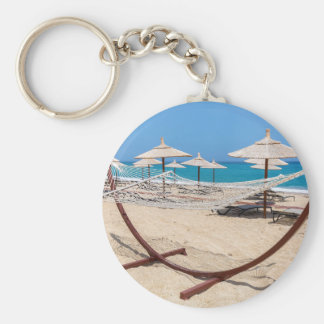 Hammock with beach umbrellas at coast keychain