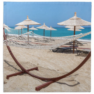 Hammock with beach umbrellas at coast napkin