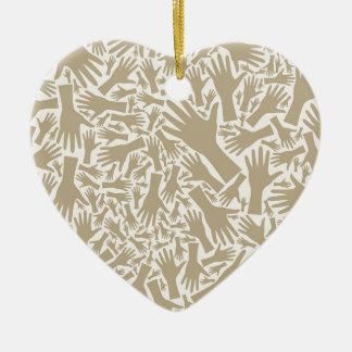 Hand background ceramic heart ornament