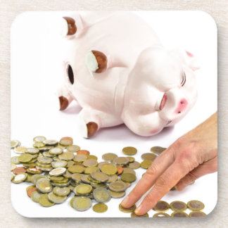 Hand counting euro coins from piggy bank coaster