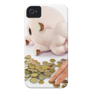 Hand counting euro coins from piggy bank iPhone 4 cases