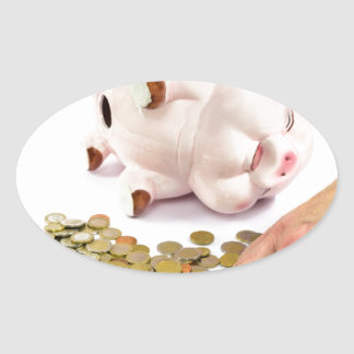 Hand counting euro coins from piggy bank oval sticker