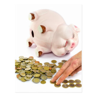 Hand counting euro coins from piggy bank postcard