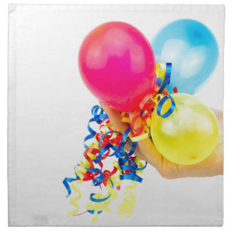 Hand giving colorful balloons with ribbons napkin