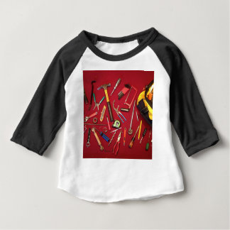 Hand held tools and tool bag red background baby T-Shirt