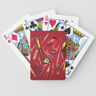 Hand held tools and tool bag red background bicycle playing cards