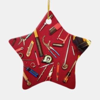 Hand held tools and tool bag red background ceramic ornament