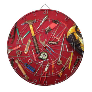 Hand held tools and tool bag red background dartboard