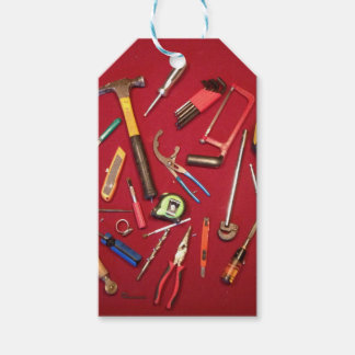 Hand held tools and tool bag red background gift tags