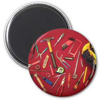 Hand held tools and tool bag red background magnet