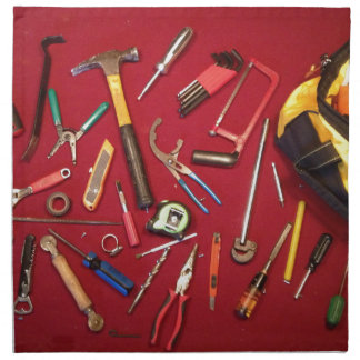 Hand held tools and tool bag red background napkin