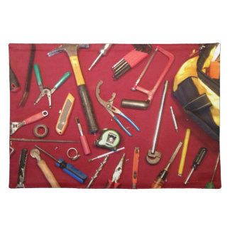 Hand held tools and tool bag red background placemat