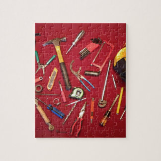 Hand held tools and tool bag red background puzzles