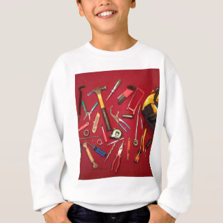Hand held tools and tool bag red background sweatshirt