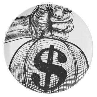 Hand Holding a Dollar Sign Burlap Sack Money Bag Plate