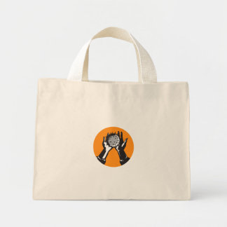 Hand Holding Ball with Spikes Circle Woodcut Mini Tote Bag