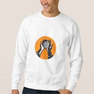 Hand Holding Ball with Spikes Circle Woodcut Sweatshirt