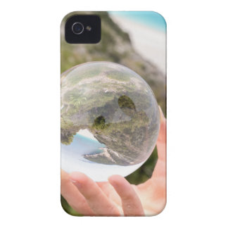 Hand holding crystal ball near sea and mountain iPhone 4 cover