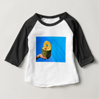 Hand holding fresh pineapple above swimming pool baby T-Shirt