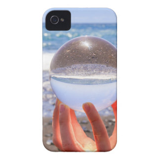 Hand holding glass sphere at beach and sea iPhone 4 Case-Mate cases