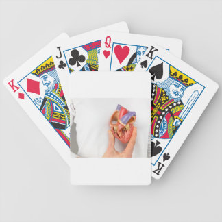 Hand holding heart model in front of chest bicycle playing cards
