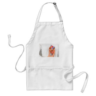 Hand holding heart model in front of chest standard apron