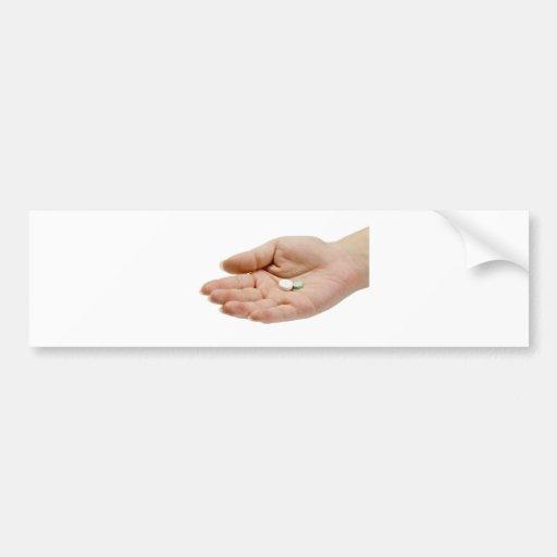 Hand holding pills bumper sticker