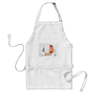 Hand holds human heart model at body standard apron