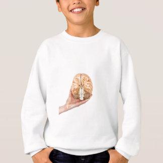 Hand holds model human brain on white background sweatshirt