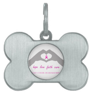 Hand making heart sign with breast cancer ribbon pet tag
