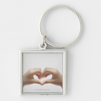 Hand of child who made shape of heart Silver-Colored square keychain