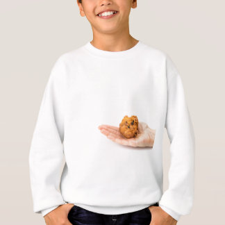 Hand palm showing fritter or oliebol sweatshirt