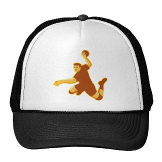 handball player jumping striking retro trucker hat