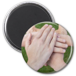 Hands arms uniting in glass sphere 2 inch round magnet