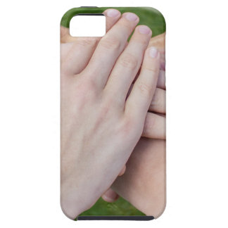 Hands arms uniting in glass sphere case for the iPhone 5