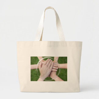 Hands arms uniting in glass sphere large tote bag