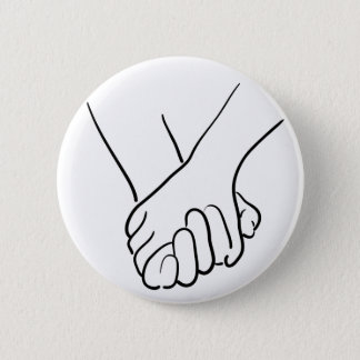 hands holding 2 inch round button