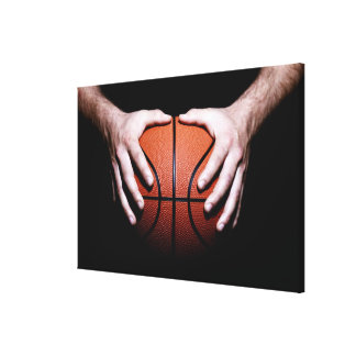Hands holding a basketball canvas print