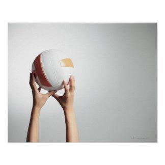 Hands holding a volleyball,hands close-up poster